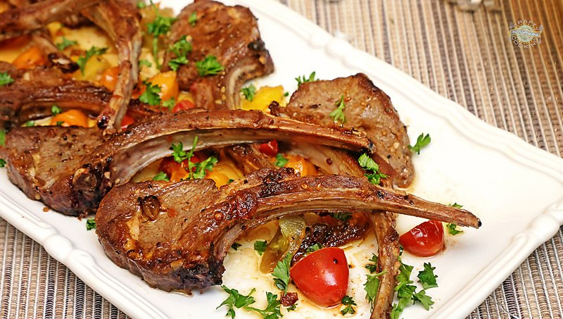 Marinated and Seared Rack of Lamb with garlic and tomatoes