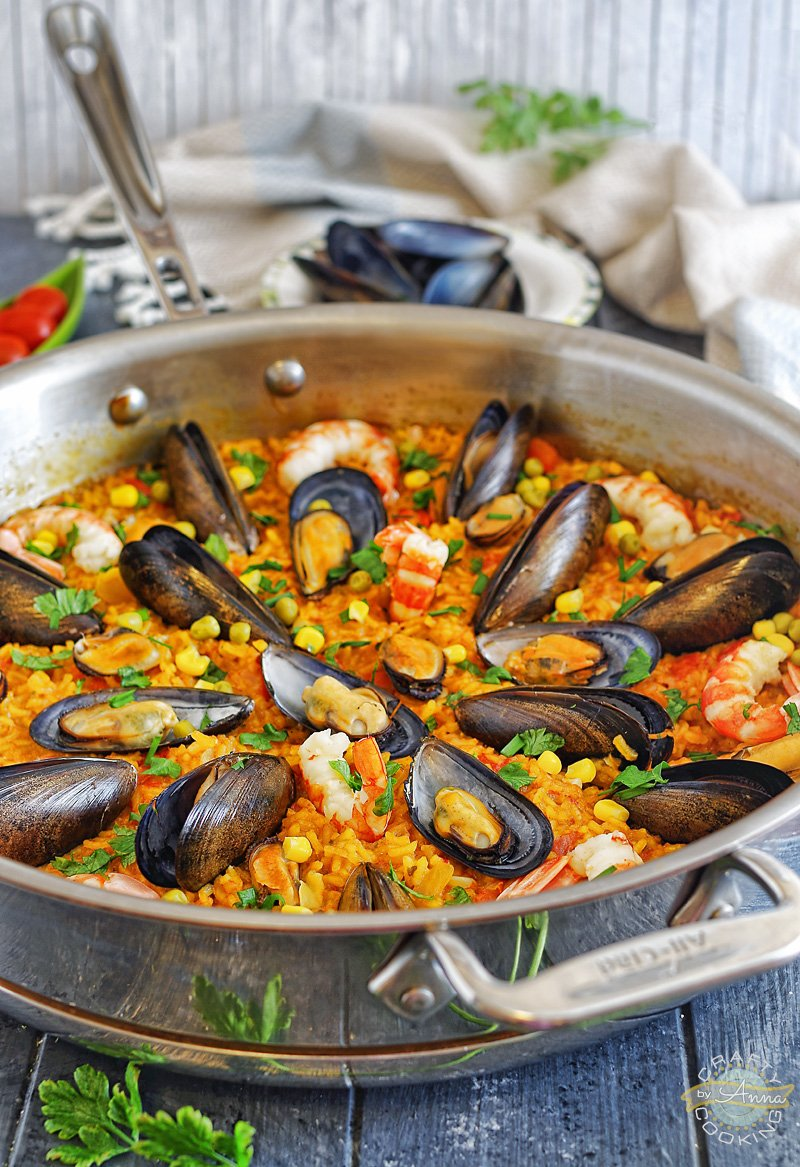 """🥘 Seafood Paella! An easy version of the classic Spanish dish that is easy enough to prepare for a weeknight dinner, but delicious enough to serve to company.  RECIPE: https://www.craftycookingbyanna.com/seafood-paella/  """"Pin"""" for later: https://www.pinterest.com/pin/574349758725918860/  #SeafoodPaella #Paella #Recipes #Cooking #CraftyCookingByAnna"""