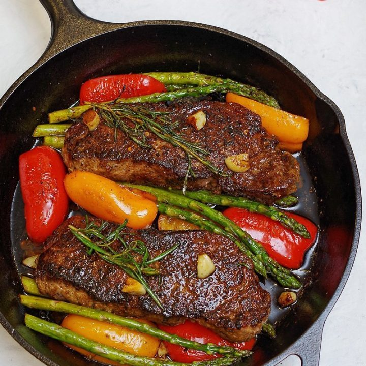 One Pan Seared Strip Steak with Garlic, Rosemary, Butter and Veggies