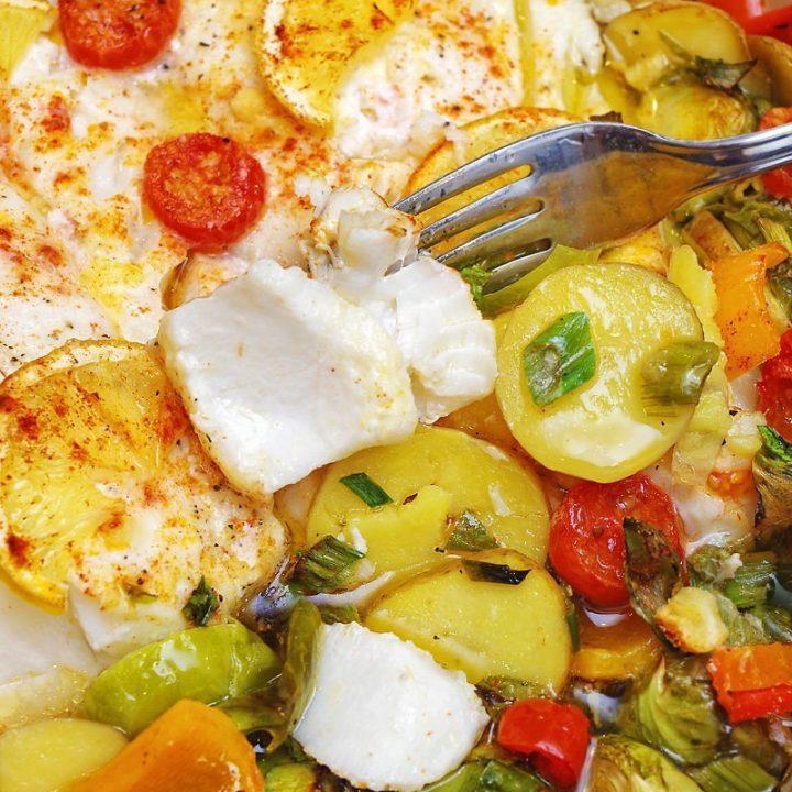 Baked Wild Cod with veggies in Lemon Garlic White Wine Sauce