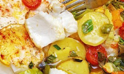 Baked Wild Cod with veggies in Lemon Garlic White Wine Sauce