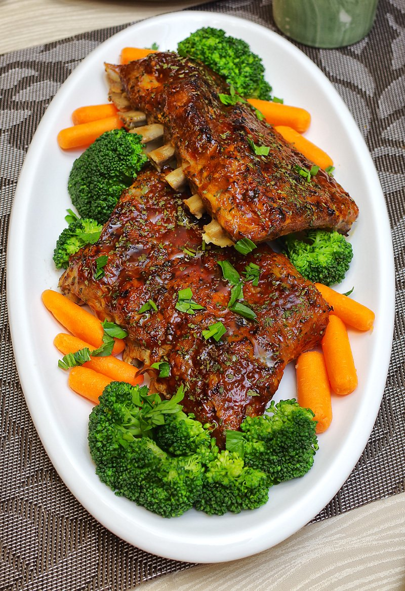 Fall-of-the-bone BBQ Baby Back ribs with broccoli and carrots
