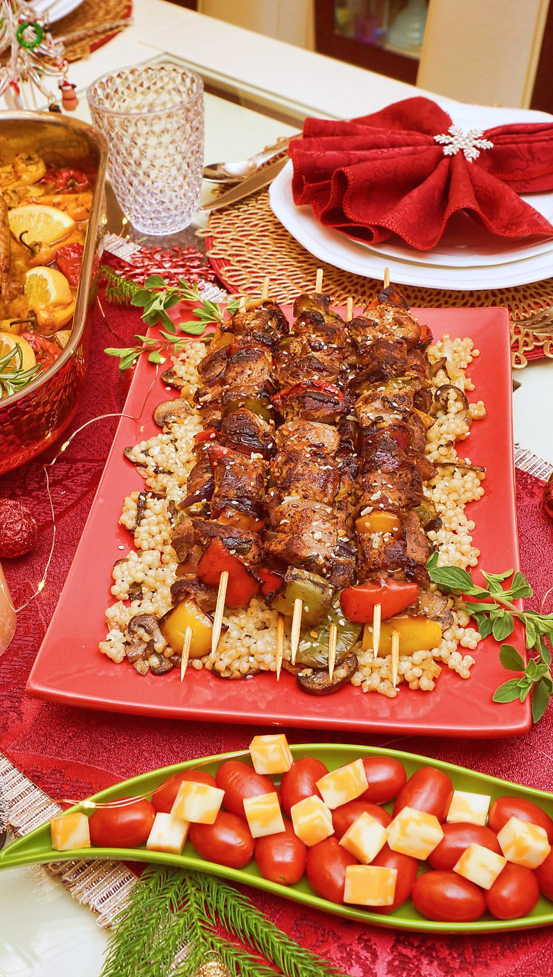 Grilled Lamb kebobs on the bed of pearled couscous with caramelized mushrooms and onions