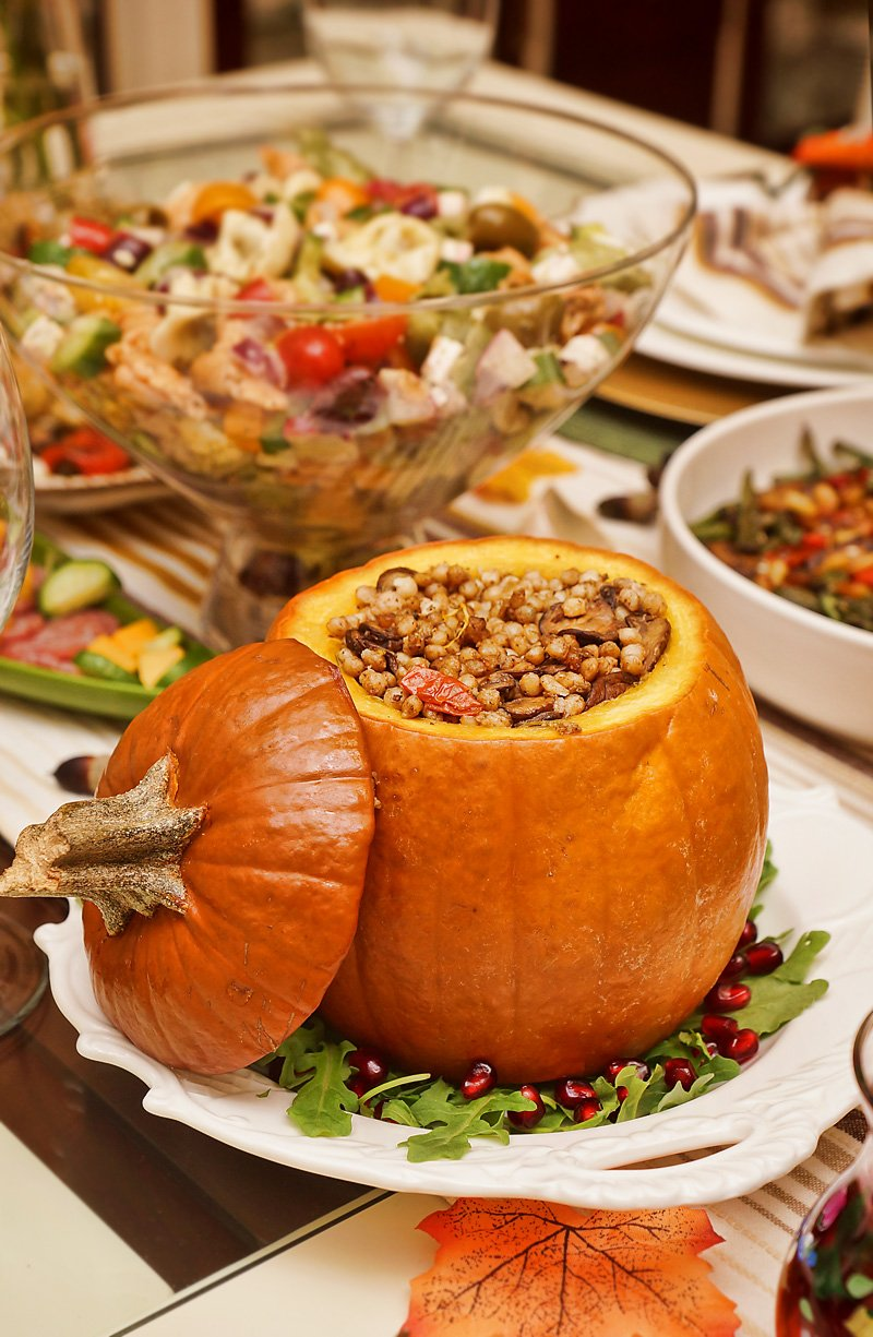 Pumpkin stuffed with Pearlized Couscous, onions, mushrooms, and tomatoes