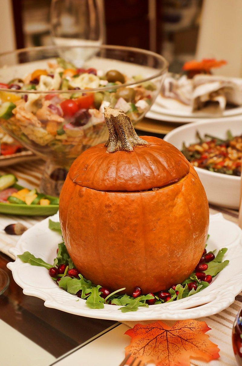 Pumpkin stuffed with Pearlized Couscous, onions, mushrooms, and tomatoes closed