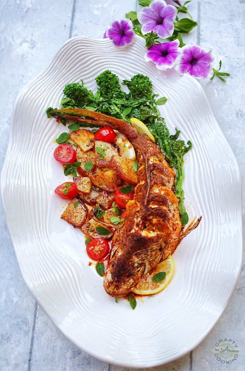 Yellowtail Snapper served with potatoes and garlic parmesan rapini top